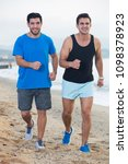 adult men are jogging together... | Shutterstock . vector #1098378923