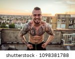 young handsome tattooed man...   Shutterstock . vector #1098381788