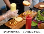 chef and his assistant adding...   Shutterstock . vector #1098395438