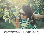 excited  cheerful young woman... | Shutterstock . vector #1098400193