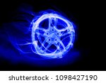 car wheel in glow and smoke | Shutterstock . vector #1098427190