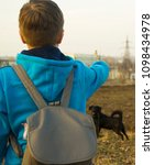 Small photo of boy playing with a dog