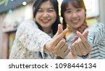 two pretty asian girls making...   Shutterstock . vector #1098444134