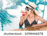 young woman in bikini swimming... | Shutterstock . vector #1098446078