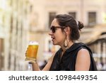 woman having a mug of cold beer ...   Shutterstock . vector #1098449354