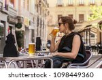 woman having a mug of cold beer ...   Shutterstock . vector #1098449360