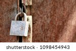 closeup of old lock on red... | Shutterstock . vector #1098454943