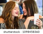 two young and trendy hipster... | Shutterstock . vector #1098458360