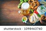 bavarian sausages with pretzels ... | Shutterstock . vector #1098463760