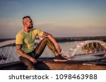 young handsome tattooed man...   Shutterstock . vector #1098463988
