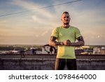 young handsome tattooed man...   Shutterstock . vector #1098464000