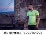 young handsome tattooed man... | Shutterstock . vector #1098464006