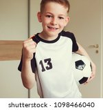 a cute boy in football suit and ... | Shutterstock . vector #1098466040