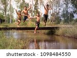 young boys jumping into river ...   Shutterstock . vector #1098484550