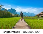 tourism with backpack walking... | Shutterstock . vector #1098503420