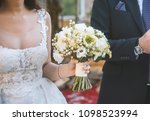 bride holds a wedding bouquet ... | Shutterstock . vector #1098523994