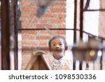 adorable little boy looking a... | Shutterstock . vector #1098530336