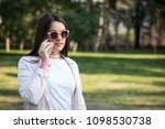 young woman talking on...   Shutterstock . vector #1098530738