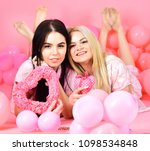women in pink pajamas posing on ... | Shutterstock . vector #1098534848