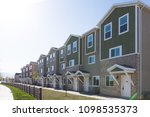 rows of cookie cutter townhouses | Shutterstock . vector #1098535373