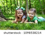 two sisters lay on the grass of ... | Shutterstock . vector #1098538214