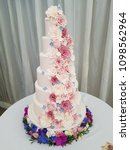 large tiered floral wedding cake | Shutterstock . vector #1098562964