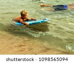 a small boy is learning to swim ... | Shutterstock . vector #1098565094