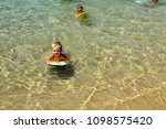 two children are swimming with... | Shutterstock . vector #1098575420