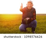 senior farmer in wheat field... | Shutterstock . vector #1098576626