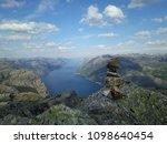 the norwegian fjord lyusebotn ... | Shutterstock . vector #1098640454