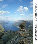 the norwegian fjord lyusebotn ... | Shutterstock . vector #1098640490