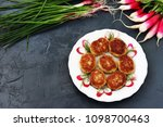 fish patties on a white plate ...