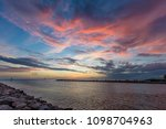 Colorful sunset over the Gulf of Mexico and the Gulf Intracoastal Waterway at the Venice Jetty in Venice Florida