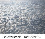 clouds from airplane window | Shutterstock . vector #1098734180