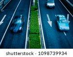 blurred car speeding on highway  | Shutterstock . vector #1098739934
