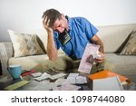 young stressed and overwhelmed... | Shutterstock . vector #1098744080