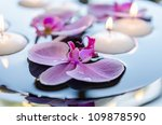 floating candle and orchid... | Shutterstock . vector #109878590