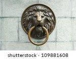 lionhead old door knocker