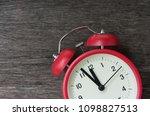 red alarm clock with few... | Shutterstock . vector #1098827513