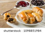 rolls with prunes on a plate on ...   Shutterstock . vector #1098851984