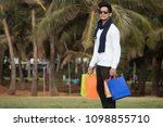 man with shopping bags | Shutterstock . vector #1098855710