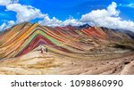 Unidentified  tourists walking on the Rainbow Mountain (Vinicunca Montana de Siete Colores - Spanish) in Cusco, Peru.