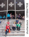 Small photo of Lhasa, Tibet / China - Oct 2017: The family of foreign tourists in the courtyard of the Potala Palace the main residence of Dalai Lama in Lhasa.