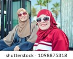 two arab ladies wearing modern... | Shutterstock . vector #1098875318