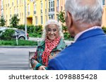 elderly modern couple on a walk ... | Shutterstock . vector #1098885428