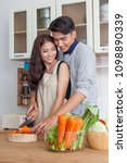 young man and woman help cook... | Shutterstock . vector #1098890339