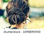 dreadlocks on the head of a... | Shutterstock . vector #1098890540