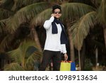 man with shopping bags talking... | Shutterstock . vector #1098913634