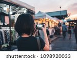 asian woman taking photo with... | Shutterstock . vector #1098920033