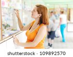 pregnant woman buys drugs at pharmacy drugstore - stock photo